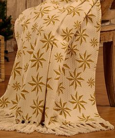 Creme & Gold Star of Wonder Woven Throw by Bella Taylor   Add festive flair to the couch with this all-cotton woven throw that's machine washable for easy care.   Cotton Machine wash; dry flat Imported  Vegan cruelty free blanket Christmas, Hannukkah, Xmas, Holidays