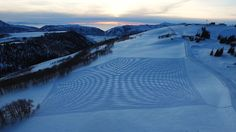 Simon Beck specializes in making ornate snow murals with just his snowshoes. The murals take an entire day to complete, and in order to really see them you have to take to the skies. Buckle in.