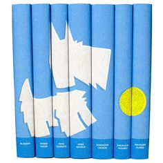 A set of classic children's books with custom book jackets featuring a blue dog illustration designed and printed by Juniper Books.