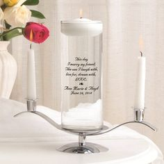 A modern twist on an old tradition, our Floating Unity Candle Set is more than just a candle. This unique addition to the wedding ceremony comes complete with personalized vase, floating candle, stand