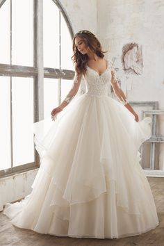 Ball gown wedding dress idea - beaded + lace bodice and layered organza skirt. Style 5517 by @morileewedding. (Top View Website)