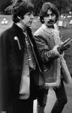 Paul and George walking by the Serpentine in Hyde Park, 18 May 1967.