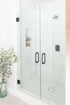 PURE SALT INTERIORS // TALEGA BEACH HOUSE PROJECT //  MASTER BATHROOM // eucalyptus, glass vase, marble, marble hexagon, airplant, shower enclosure..