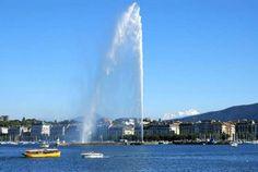 Lakefront La Rade giant fountain Jet d'eau and Mont Blanc mountians Geneva Switzerland - Image Broker/REX