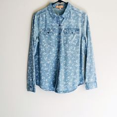 Floral Print Chambray Button Down Shirt Never worn.  Nothing says spring more than flowers and chambray. Well this shirt has them both. Perfect with white pants or shorts. Tops Button Down Shirts
