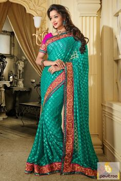 Turquoise and pink color designer Barsso fabric party wear saree make elegant embroidery lace patta border work with unstitched matching blouse materials.