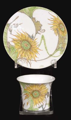 Rozenburg eggshell porcelain cup and saucuer featuring sunflowers, 1900, decorated by S. Schellink