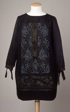 1923-25 Tunic top with scooped neckline, the front and back of black silk, the long sleeves, wrist-ties and bottom edges of tunic of silk satin.