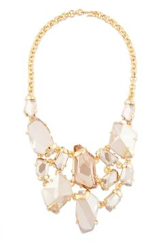 Typically I find such chunky jewelry to be over-the-top and disdainful, but this piece oozes chic.