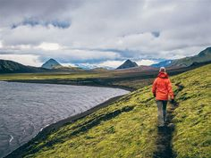 Hiking along the shore of the Alftavatn Lake, along the Laugavegurin hiking trail in Iceland