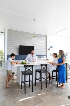 Outdoor kitchen on verandah of Hamptons style home. Hamptons Style Homes, The Hamptons, Stone Gallery, Island Bench, Custom Cushions, Dash And Albert, Luxury Pools, Arched Windows