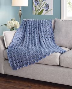 An elegant fan pattern in soft and cozy Woodlands yarn. Shown in (006) Denim or choose any color.