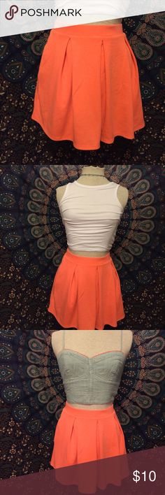 Bright Orange Pleated Skirt! Adorable bright coral/orange skirt with pleat detail to give it a really nice shape! This skirt lies so nice and looks great with crop tops! The denim crop top is also for sale in my closet and it is the top I hunted for to fi