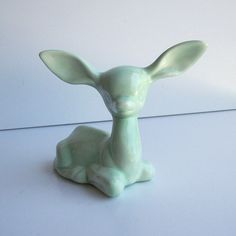 Ceramic Deer .. reminds me of one that Grandma had... will have to spray paint it.  Love this color.