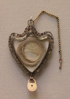 Locket with Hair from Queen Marie Antoinette http://softwaring.tumblr.com/post/172398575009/waifeyes-gold-locket-with-the-hair-of-queen