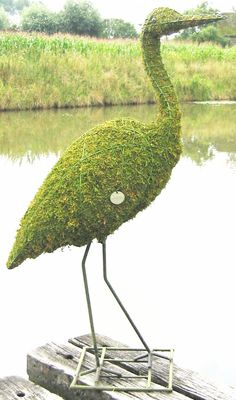 Topiary Stork With Moss Filling Hopefully this graceful stork won't eat as many of your fish as the real versions do. This beautiful topiary cage is perfect for placing b