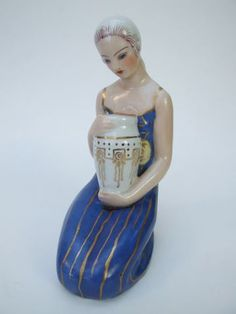 Perfume Lamp by Aladin  Pretty ceramic perfume lamp. Made by the Aladin company in the late 1920's - early 1930's. Signed to the base Aladin Luxe made in France and beautifully hand painted. She measures 7.75 inches