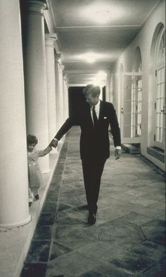 JFK putting his son to bed