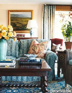 Designer Michael S. Smith used a mix of patterns in this family room to keep it cozy.