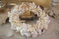 on my list to do for summer.  I have oodles of shells waiting to be put to use....