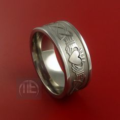 Hey, I found this really awesome Etsy listing at http://www.etsy.com/listing/80659886/titanium-celtic-irish-claddagh-ring