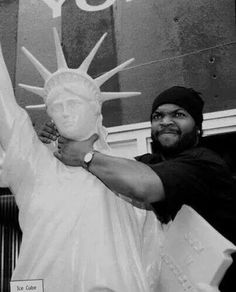 Ice Cube choking the statue of liberty... The land of the free or not...   In an interview with British newspaper The Guardian, Ice Cube stated that he is a Muslim, having converted in the 1990s. He described his Muslim faith as a simple, personal one that does not involve attending prayer services or following rituals. Although he has spoken favorably of the Nation of Islam, he denied ever being in the organization.