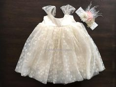 This chic French Summer Baby Baptism Dress is absolutely stunning. Part of my Baby Bonbon Vintage Collection, this baby girl dress has a French flare. For your baby's comfort, it is made using soft fabrics in a stunning French White color. It has multi-layered tulle to add volume and a cotton liner for full chest and skirt coverage. The delicate lace completes the French Vintage design. The headband is handmade with beautiful flowers in your choice of gorgeous color. This Baby Bonbon Ball...