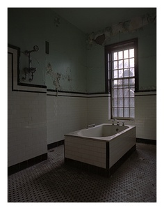 Taunton Lunatic Asylum Bathrooms.... is there someone standing in the window?