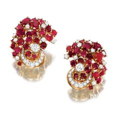 PAIR OF RUBY AND DIAMOND EARCLIPS, MEISTER.  Each designed as a cluster of oval rubies highlighted by circular- and brilliant-cut diamonds, mounted in yellow and white gold,    signed Meister.