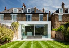 Rear light well with external steps and a glass balustrade to large garden. Contemporary rendered extension to a Victorian London home Architects London, Glass Balustrade, Victorian London, Residential Architect, Home Cinemas, Open Plan Kitchen, Contemporary, Modern, Home And Family