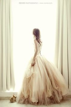 This wedding dress reminds me of a nymph or fairy it's so wispy.