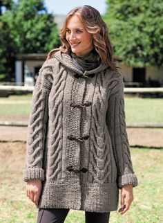 This hooded coat is knitted with Duvetine yarn. Large structured cables accentuate the silhouette. The wide, ribbed edges and hood are knitted in beaded rib. The coat is fastened using 4 toggle and loop fastenings in faux suede. It is knitted using a Hooded Cardigan, Cardigan Pattern, Jacket Pattern, Long Cardigan, Love Knitting, Knitting Patterns Free, Hand Knitting, Free Pattern, Knitting Needles
