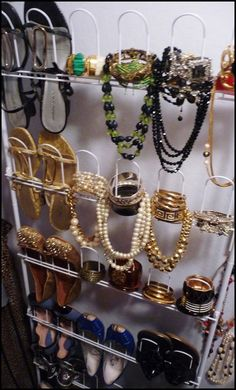 Use a Wall Shoe Organizer to store necklaces, bracelets / bangles.