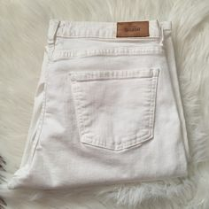 Kate spade saturday white jeans Worn once and overall great condition. One tiny stain in the back under pocket. Kate spade tag shed color a bit. Stretchy and soft. Offers welcome through offer tab. No trades. kate spade Jeans