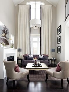Chic white living room with dark wood floor