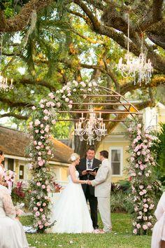 Garden wedding ceremony under a chandelier