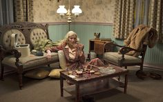 """In this scene, Carol lounges in the Presidential Suite of the McKinley, a theme motel that the production team built out of an abandoned hotel in Ohio. """"We completely reconfigured it. We found this great Americana wallpaper and put up wainscoting. We wanted to try to get the presidential theme across without being ridiculous. It was fun to incorporate red, white, and blue into our basic color palette. I think it gives the set a unique look."""""""
