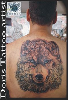 Big wolf back tattoo