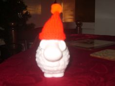 Having bought a sheep ornament, I just had to make him a Christmas hat!