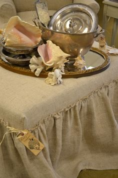 great vignette on a burlap covered ottoman