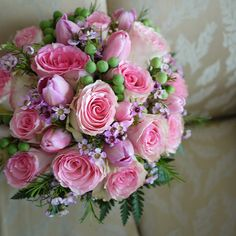 Equadorian roses, wax flowers , tulips and green berries