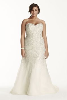 dfdb6599ef61 You\& be a flawlessly beautiful bride as you walk down the aisle in this  crystal beaded tulle gown! Fitted strapless sweetheart bodice features  intircate ...