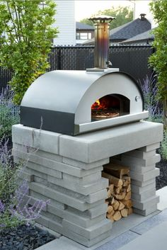 This modern outdoor pizza oven appliance is made with high quality stainless steel. Efficient, durable, and sophisticated for your outdoor kitchen. Modern Outdoor Pizza Ovens, Outdoor Kitchen Plans, Modern Outdoor Kitchen, Outdoor Cooking Area, Pizza Oven Outdoor, Outdoor Dining, Outdoor Rugs, Brick Oven Outdoor, Small Outdoor Kitchens