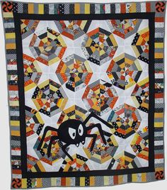 This is my second quilt. I didn't want it to just be for Halloween, so I didn't use Halloween fabrics, but I thought my little grandson would like the spider. Since it is the spiderweb block, it made sense. I hand appliqued the spider.