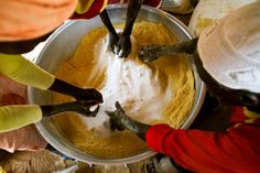 Volunteers of the international NGO Kuwait Patients Helping Fund prepare a mixture for feeding malnourished children, as well as pregnant and lactating women, in Abu Shouk camp for Internally Displaced Persons (IDP), North Darfur. Distributed by the World food Programme (WFP), the mixture is composed of corn, soy, wheat, sugar and oil. Credit: UN Photo/Albert González Farran Photo Date: 25/09/2013
