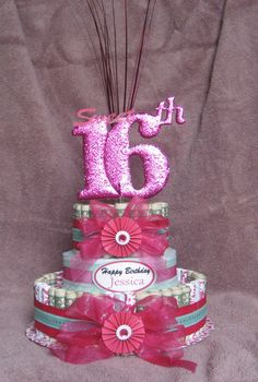 """Money Cakes from Creative Creations by MC, Is a great, unique and fun way to give a sweet treat you don't eat!  Send a Unique Fun Gift to a Sweet Sixteen """" 16th Birthday"""".......with a money cake!  Money cakes are approximately 10"""" x 12"""" they are available in denominations of $25, $50, $75 $100, $150 and $200. The cakes are made with real money most cakes are made with $1, upon your request I can m"""