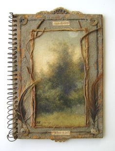 a notebook with original art and found objects