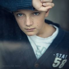 by Magdalena Berny - as a rule the most compelling photos of children are when they're not smiling. Telling children to smile at the camera results in images that say nothing about them except that they can fake an expression. Parents, take note.
