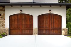 Custom handcrafted wood carriage house garage doors offered in many wood species. Carriage House Garage Doors, Wood Garage Doors, Garage Door Insulation, Outside Paint, Stucco Homes, Pentagon, Custom Wood, House Painting, Rustic Style