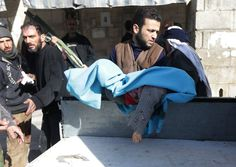 A man carries the body of a dead child after an airstrike. This image is from...